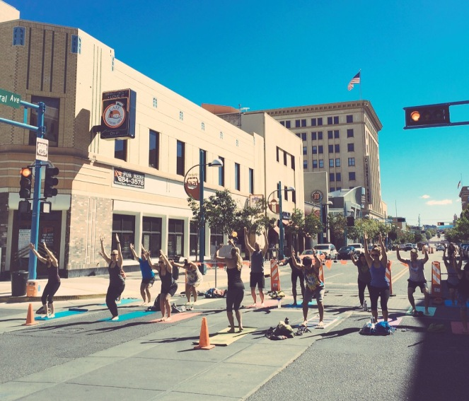 People doing yoga on Central Avenue during ABQ CiQlovia, 2015